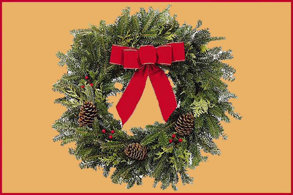 Green wreath with red ribbon, red berries and pine cones