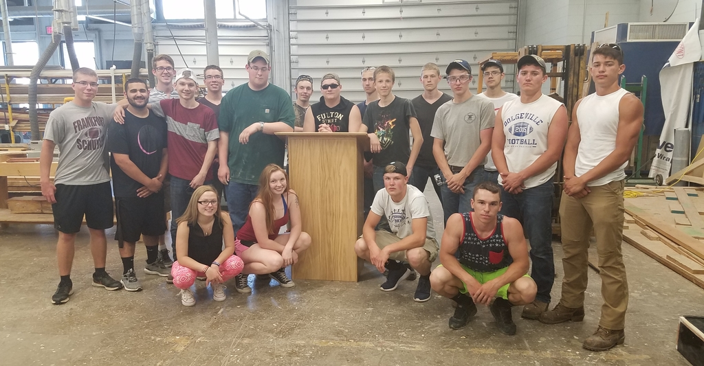 Building Construction students pose with a podium they built for police