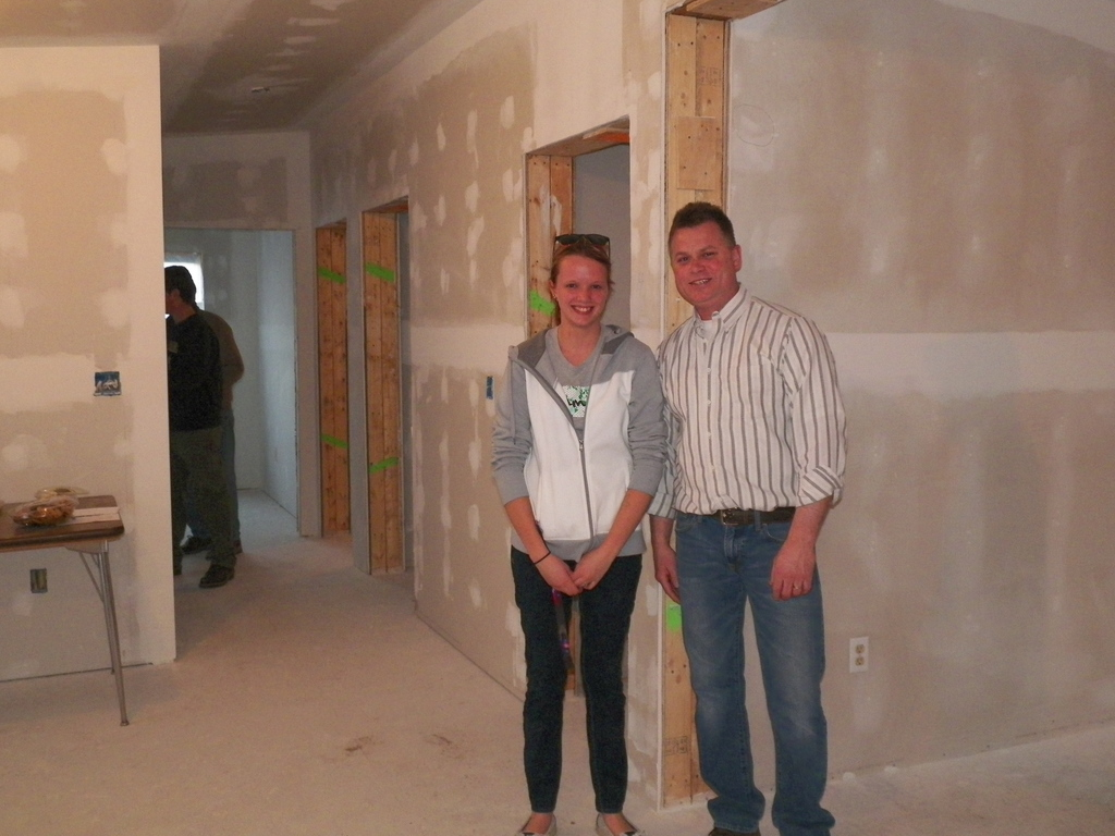 Building Construction student posing with instructor John Martin in house being built
