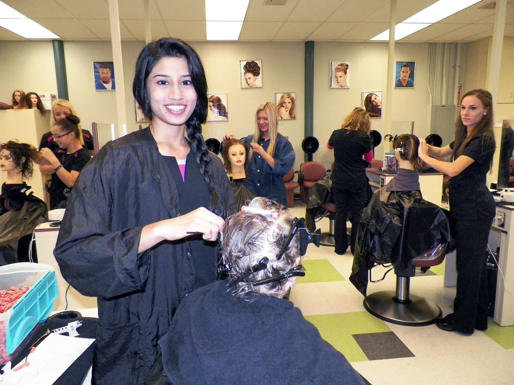 Cosmetology student working on a mannequin