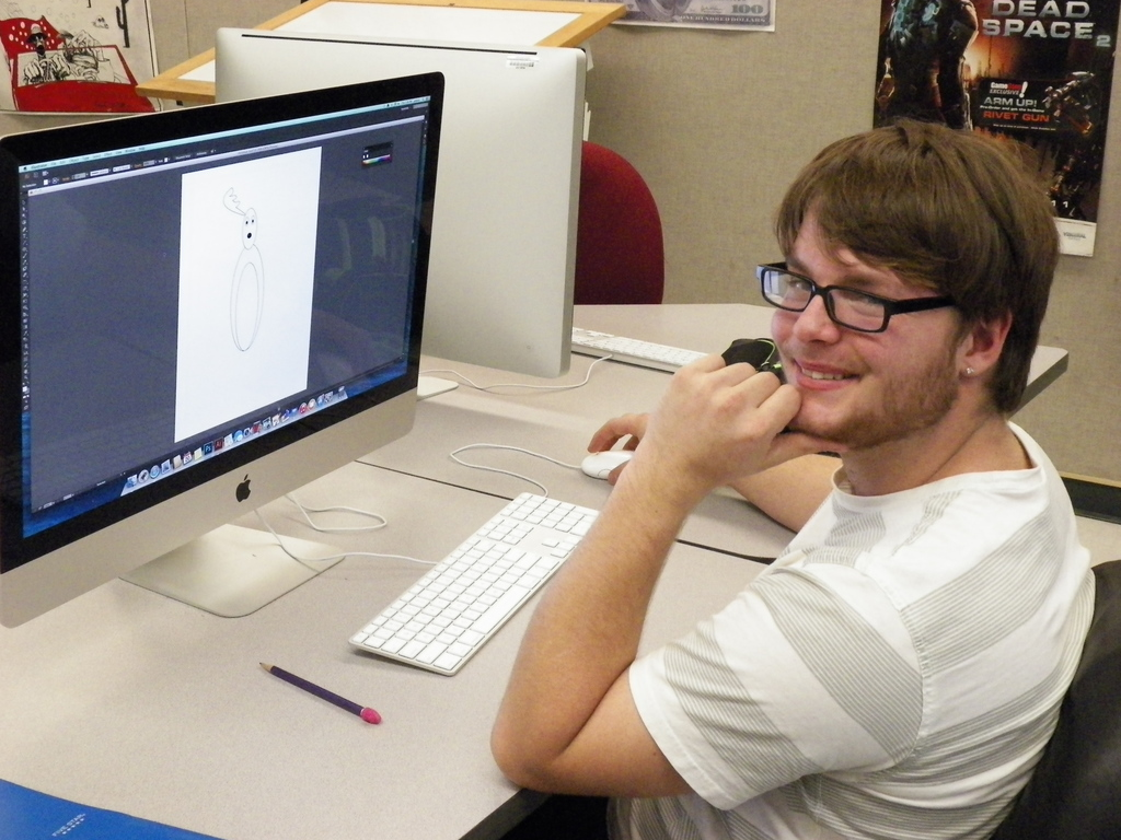 Visual Communications student working on a computer