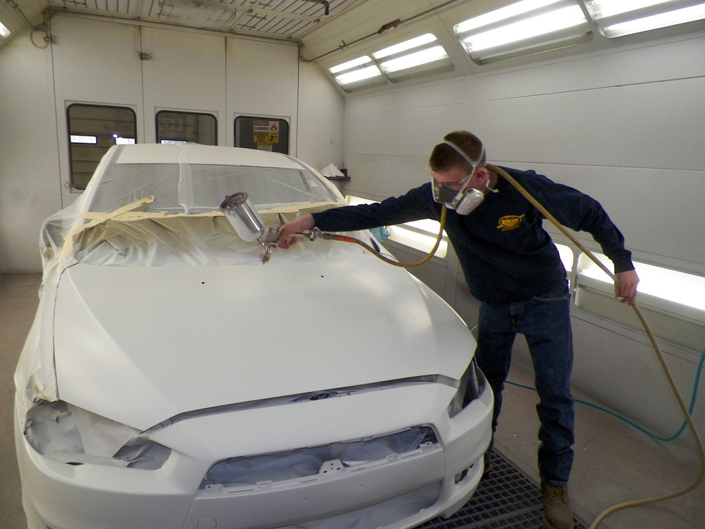 Student painting a car