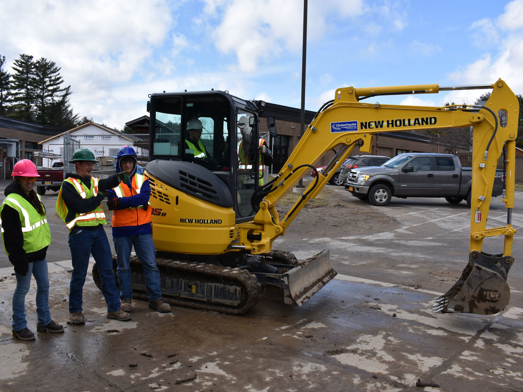 Heavy equipment students operate machinery