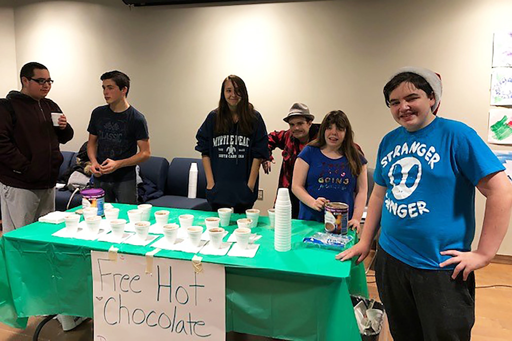 VP-TECH student council members by a table with a sign saying free hot chocolate