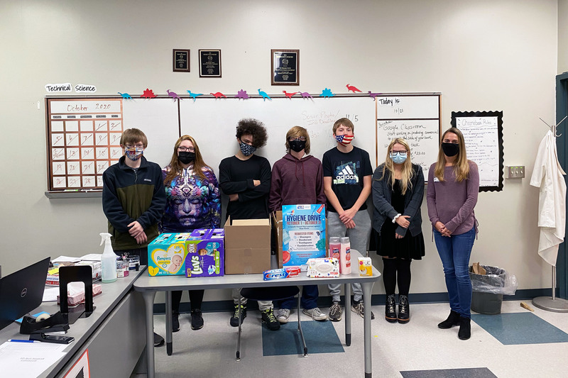 VP-TECH Council students pose with a United Way representative and hygiene items that were donated